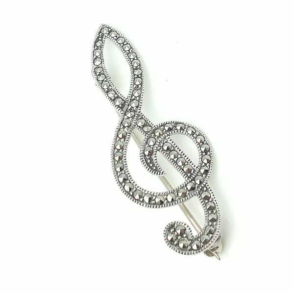 Brooch, treble clef