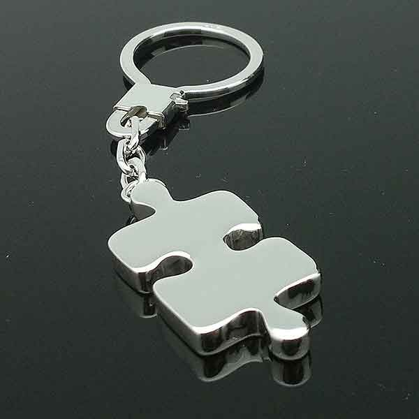 Keychain with shaped puzzle piece