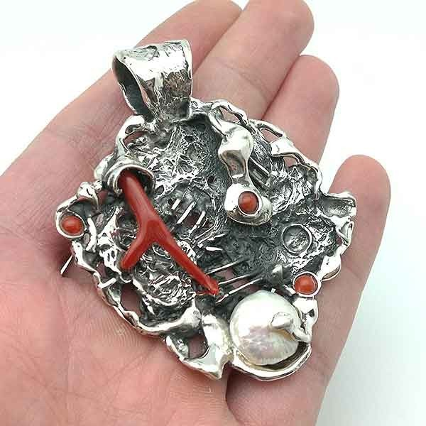 Silver and coral pendant