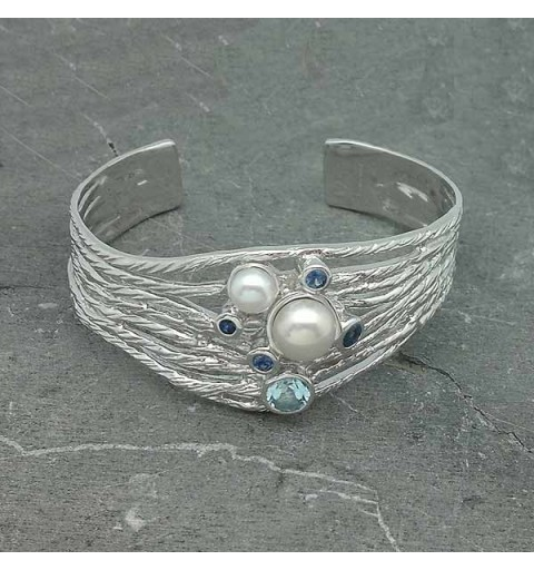 Silver bracelet and natural stones