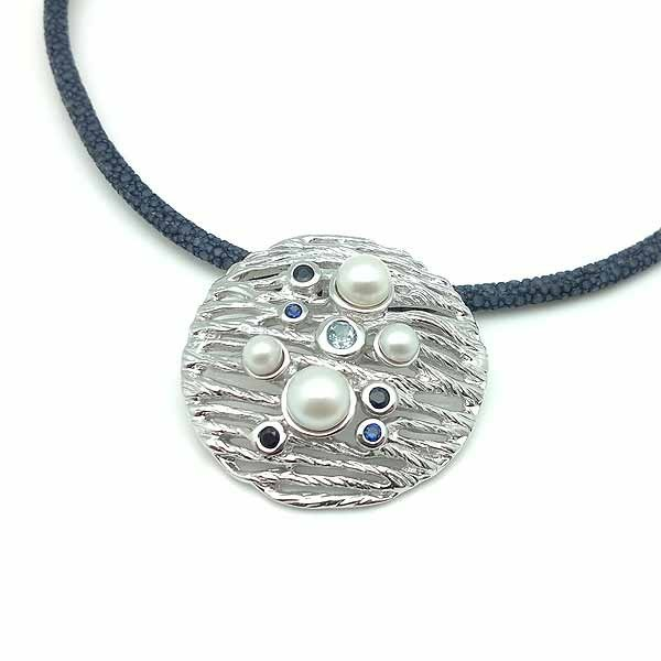 Silver pendant and natural stones