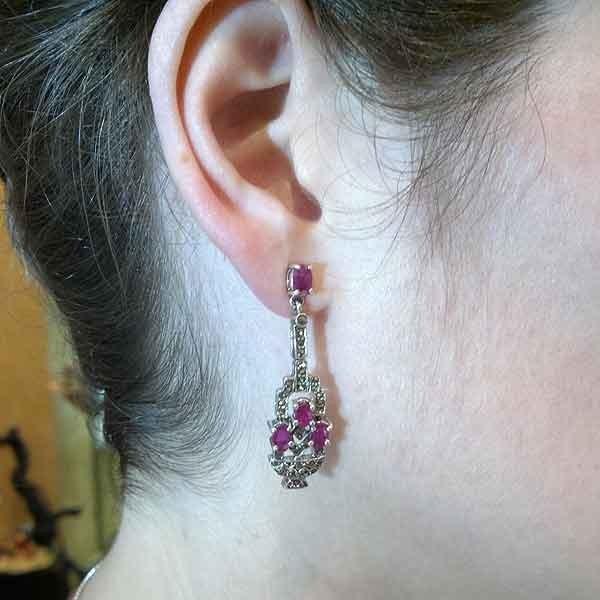 Silver earrings and rubies