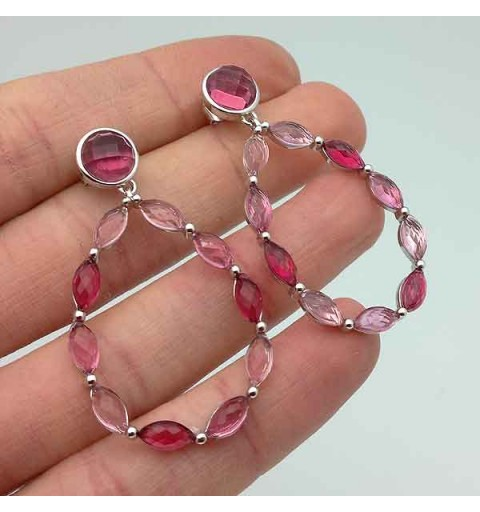Long earrings in sterling silver with pink tones.