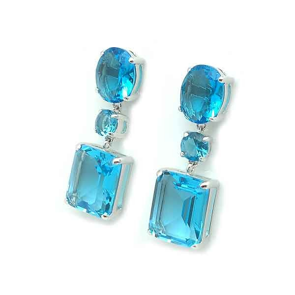 Silver earrings and zircons, aquamarine tone.