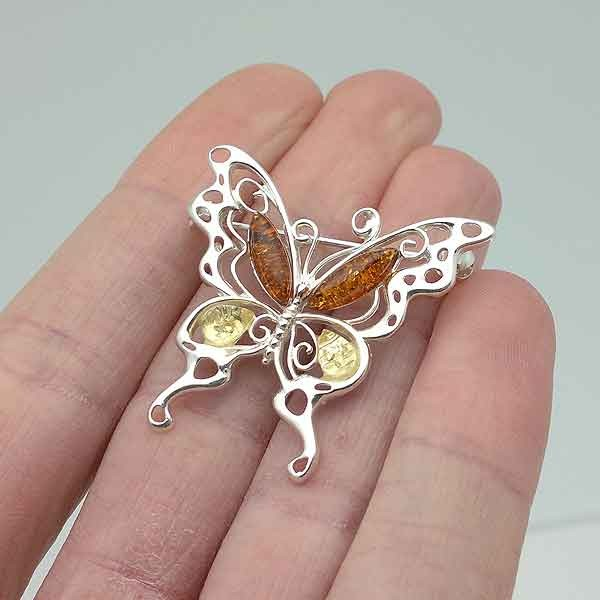 Butterfly amber brooch