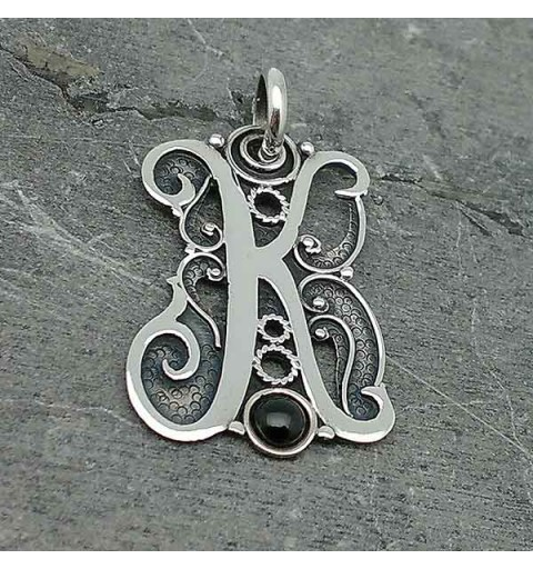 Initial in silver and jet, letter K.