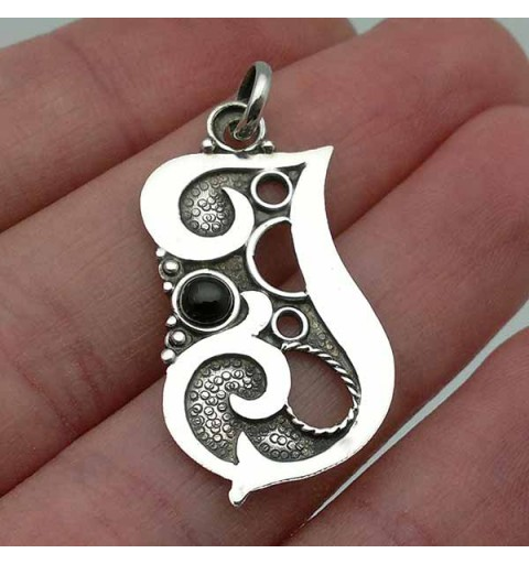 Silver pendant with the letter J.