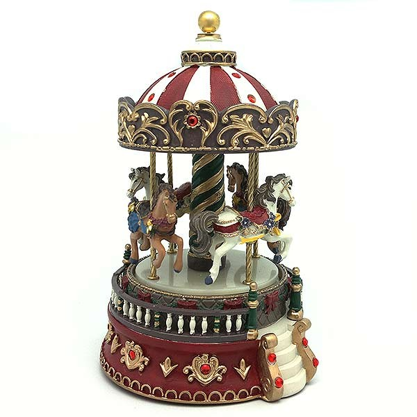 Musical carousel in red and green tones.