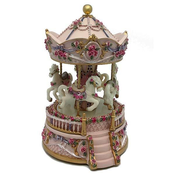 Musical carousel in pink tones.