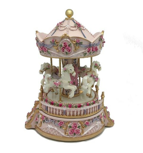 Musical carousel in pink tones.