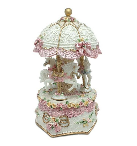 Musical carousel with light, in pink tones.