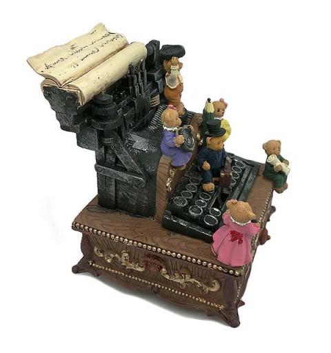 Caja de música con forma de máquina de escribir.