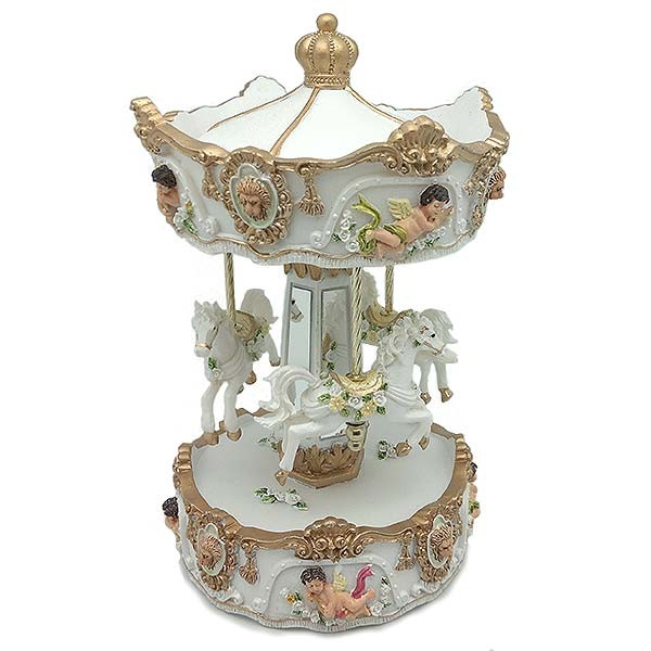 Musical carousel, in white and gold tones