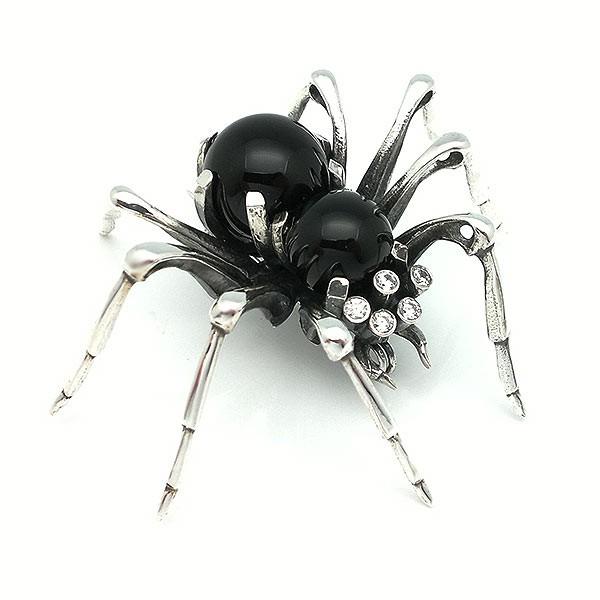 Broche con forma de araña, en plata de ley