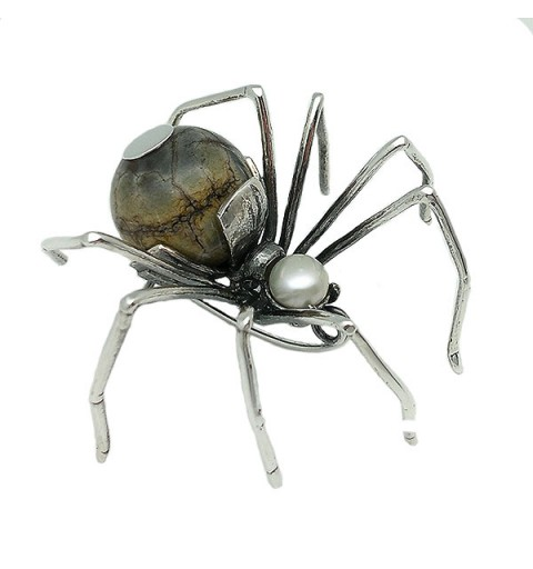 Spider shaped brooch in sterling silver.
