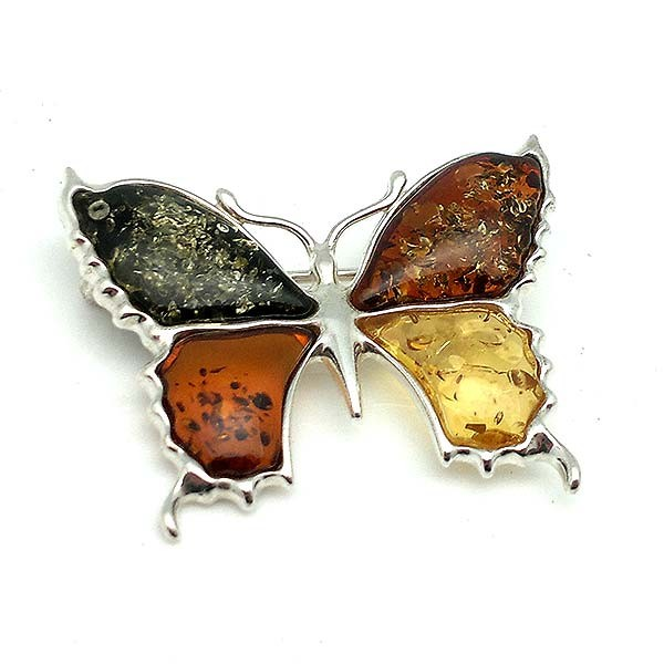 Butterfly brooch, in silver and amber