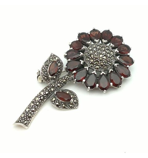 Flower brooch, in silver and garnets.