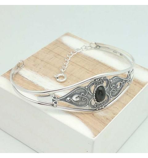 Rigid bracelet, silver and jet.