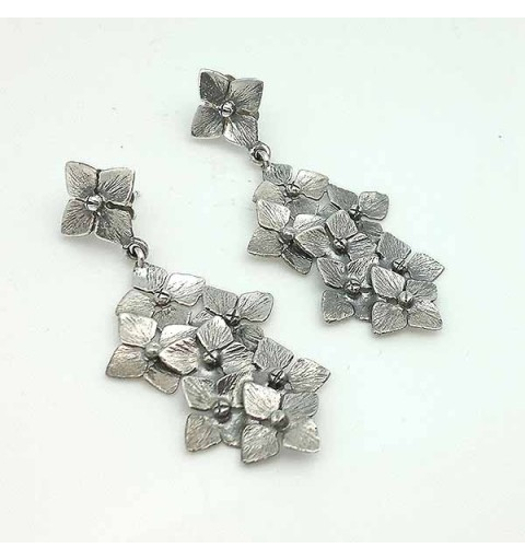 Long sterling silver designer earrings with many flowers.