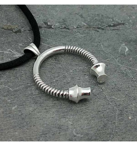 Torque pendant in sterling silver.