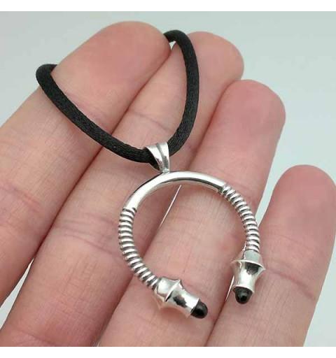 Unisex pendant, shaped like a torque.