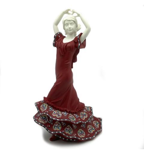 Sevillana grande, con vestido rojo.