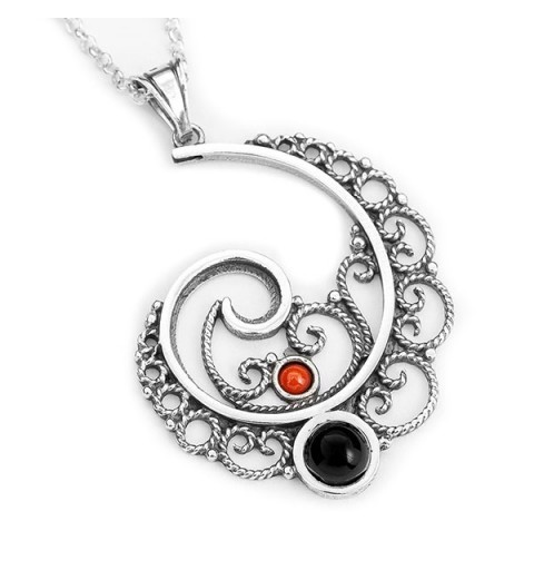 Circular pendant, in silver, jet and coral.