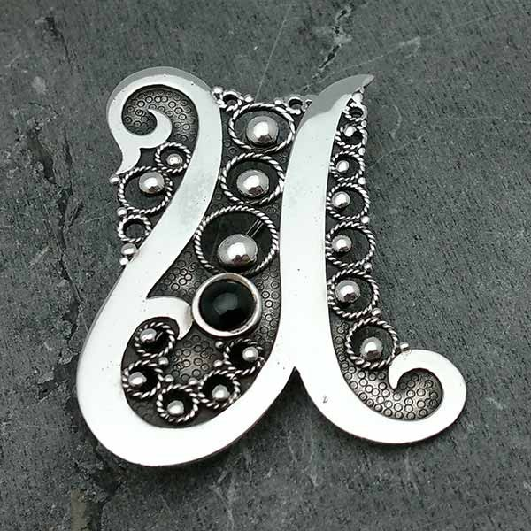 Brooch, letter u, made of sterling silver.