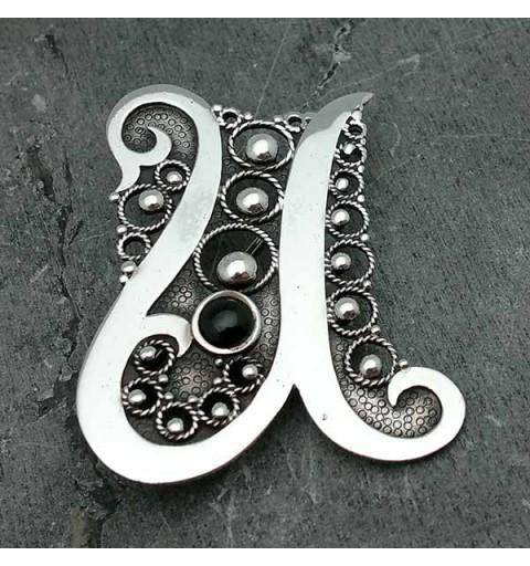 Brooch, letter u, made of sterling silver.
