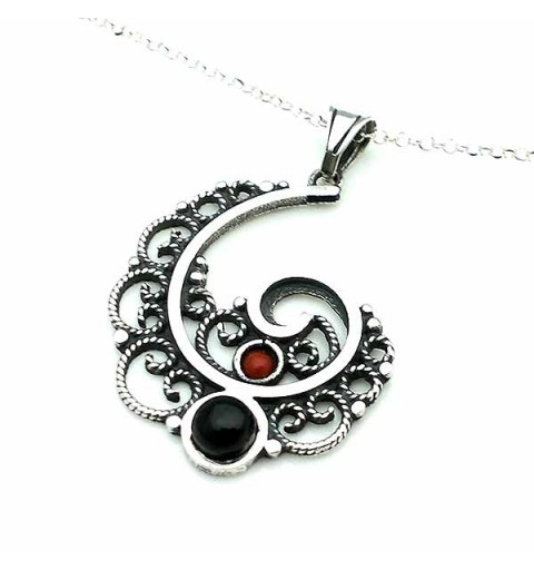 Pendant, made in the shape of a spiral, in sterling silver, jet and coral.