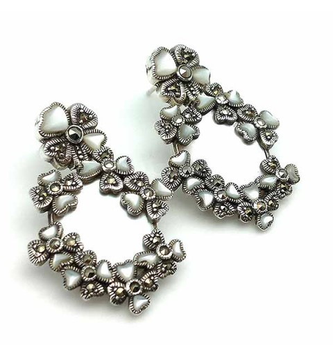 Earrings adorned with flowers, made of sterling silver, mother-of-pearl and marcasites.