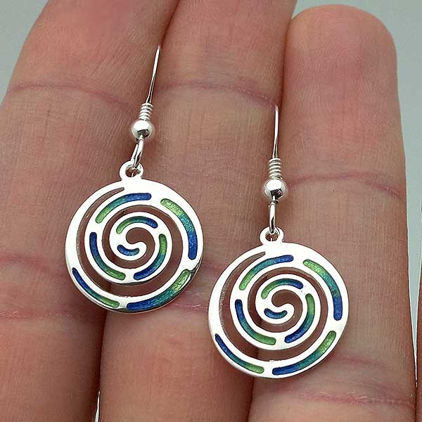 Earrings with the Celtic symbol of the spiral, in silver and fire enamel.