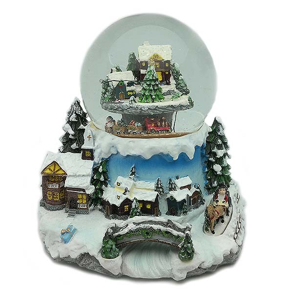 Christmas snowball, with train passing under the town.