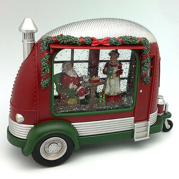 Christmas lantern, shaped like a caravan, in which we can see Santa Claus having dinner on Christmas Eve.