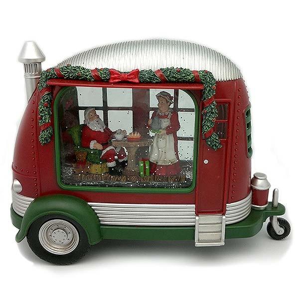 Farolillo navideño, con forma de caravana, en la que podemos ver a Papá Noel tomando la cena el día de Noche Buena.