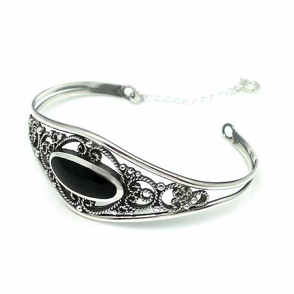 Bangle type bracelet, in silver and jet.