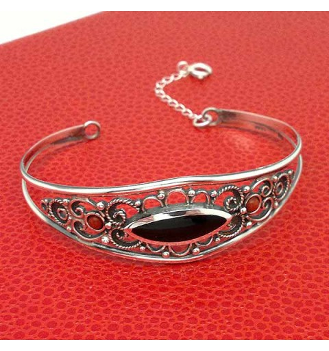 Rigid bracelet, in sterling silver, jet and coral.