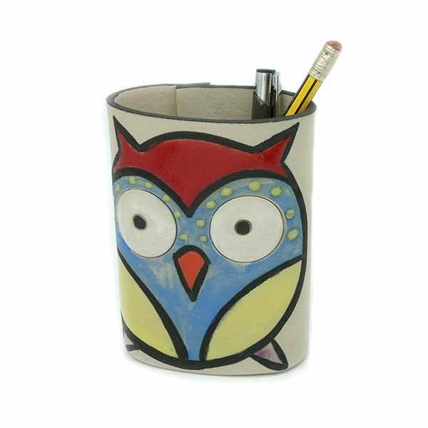 Ceramic owl-shaped pencil holder.