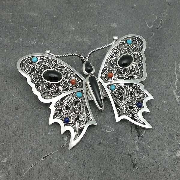 Brooch and pendant, in the shape of a butterfly, made by hand, in sterling silver and natural pieces.