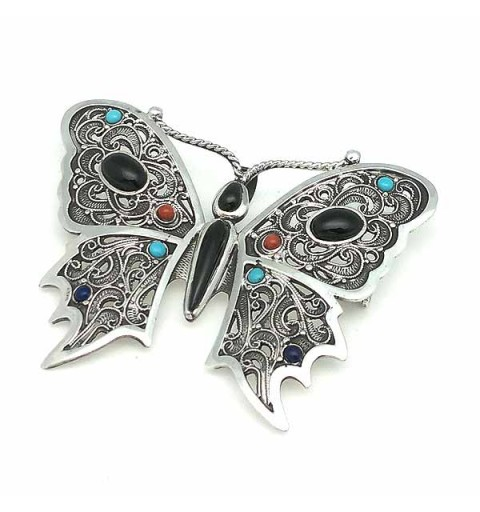 Broche y colgante, con forma de mariposa, elaborado de forma artesanal, en plata de ley y piezas naturales.