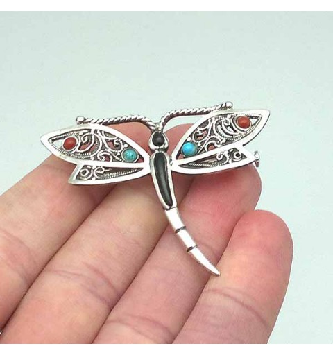 Dragonfly brooch, in sterling silver, jet, coral and turquoise.