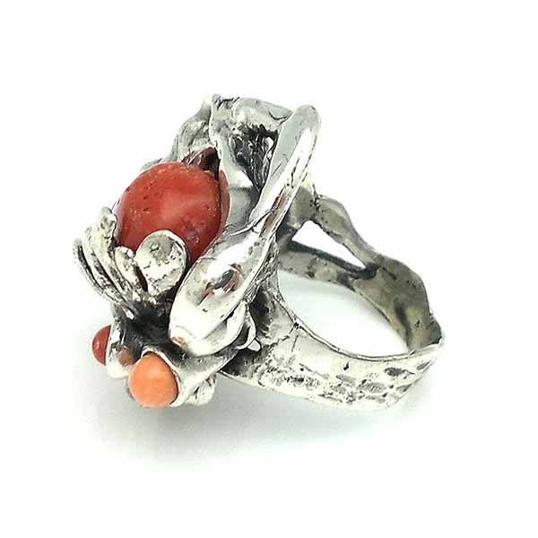 Baroque style ring, made of sterling silver and natural coral.