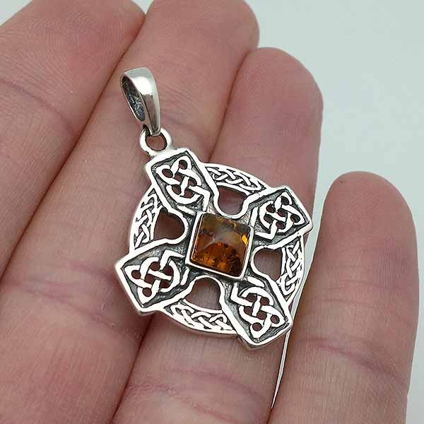 Celtic cross, in sterling silver and amber.