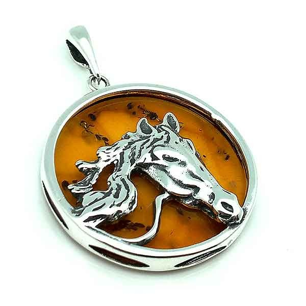 Horse pendant, in sterling silver and amber.