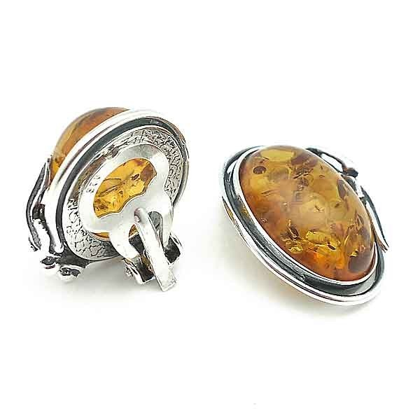 Clip earrings, silver and amber