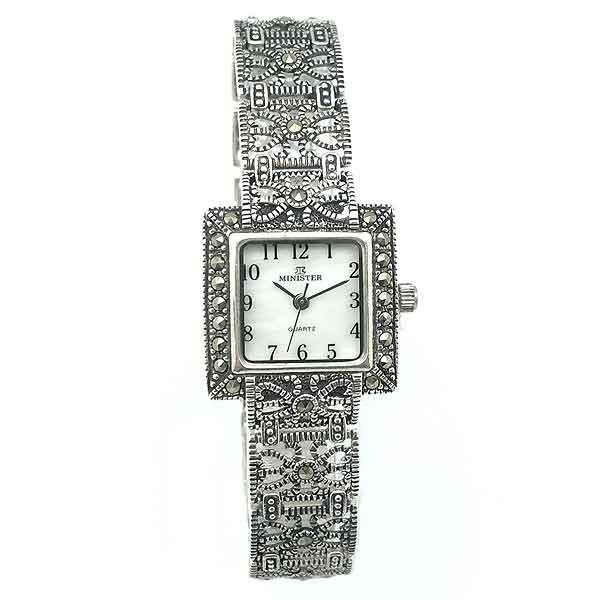 Clock lady in silver.